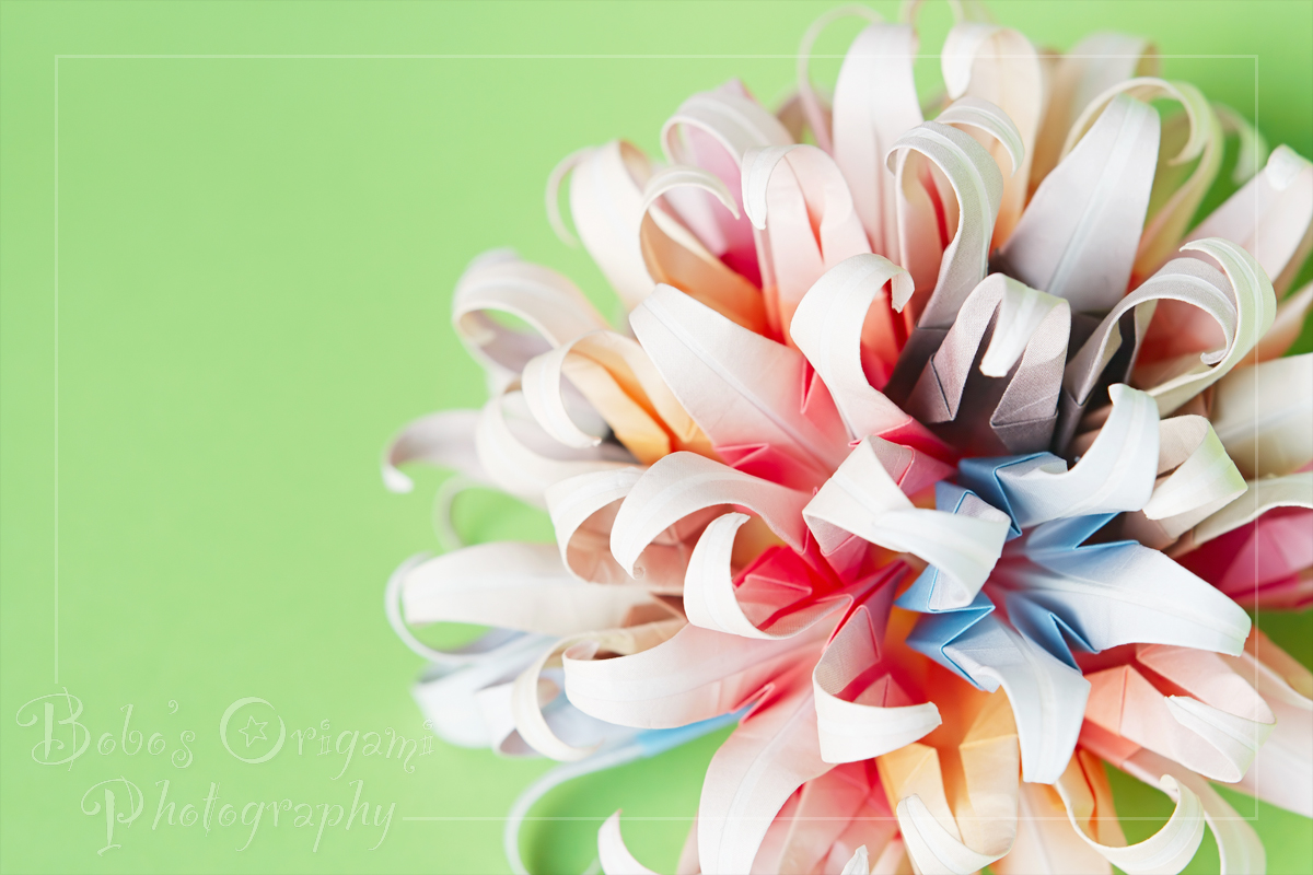 Paper Flower Ball On Green Bobos Origami Photography